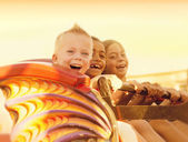 Kids on a Summertime Roller Coaster Ride — Stock Photo