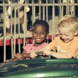 Kids on an amusement park ride — Stock Photo