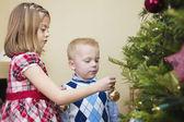 Kids decorating a christmas tree — Stock Photo