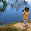 Little Boy Catching a Fish — Stock Photo