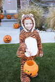Little Boy in Costume Trick-or-treating on Halloween — Stock Photo