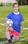Cute little Soccer player portrait (girl) — Stockfoto