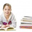 School Girl smiling while reading books — Stock Photo