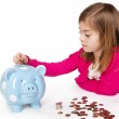 Child Saving money in a piggy bank — Stock Photo #40425837