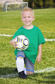 Cute little Soccer player portrait (boy) — Stockfoto