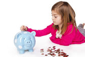 Child Saving money in a piggy bank — Stock Photo