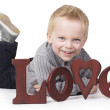 Adorable little boy sending out a message of love — Stockfoto