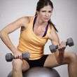Beautiful fitness woman doing free weight training — Stock Photo
