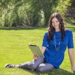 Beautiful woman using a tablet PC outdoors — Stock Photo #40439541