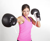 Woman boxing at a gym — Stock Photo