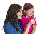 Woman and daughter looking and pointing — Stock Photo