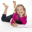 Cute little girl doing her homework — Stock Photo #40447333