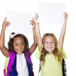Two cute kids holding up a blank sign — Stock Photo