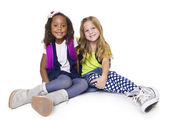 Two diverse little school children — Stock Photo