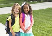 Cute little girls walking to school together — Zdjęcie stockowe