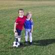 Two Young Soccer Players From Different Teams On A Grass Field Ready To Play — Stock Photo