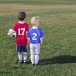 Two Young Soccer Players From Different Teams On A Grass Field Ready To Play — Stock Photo #40461925