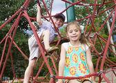 Kids climbing on a outdoor playground — Stockfoto