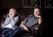 Children watching Shocking Television Programming — Stock Photo