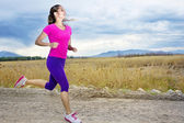 Hispanic female runner outdoors — Stock Photo