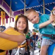 Kids having fun on a carnival carousel — Stock Photo #40836065