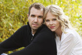Portrait of a beautiful young couple outdoors — Stock Photo