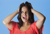 Crazed and frustrated woman pulling her hair — Stock Photo