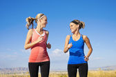 Two beautiful Women Jogging Together — Stock Photo