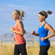 Stock Photo: Female Runners on jog outdoors (side view)