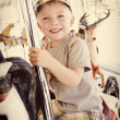 Little Boy on a Carnival Carousel — Stock Photo #40842793