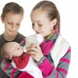 Stock Photo: Siblings Caring for their new Baby Brother