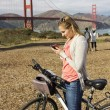 Stock Photo: Woman using a smart phone on vacation