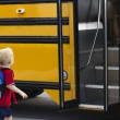 Child getting on a school bus — Stock Photo #40844821