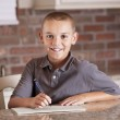 Handsome young man studying and writing — Stock Photo