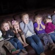 Stock Photo: Children watching Shocking Television Programming