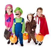 Halloween Trick-or-Treaters in their costumes — Stock Photo