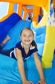 Kids playing on an inflatable slide bounce house — Stock Photo
