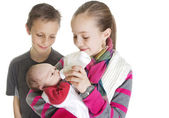 Siblings Caring for their new Baby Brother — Stock Photo