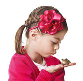 Little Princess kissing a frog — Stock Photo