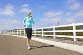 Female Jogger running outdoors — Stock Photo