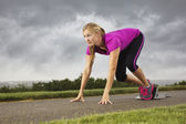 Fit Middle-Aged Female Ready to Sprint — Stock Photo