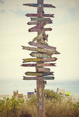 Directional Sign Post on the Beach — Stock Photo