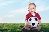 Cute Little Boy  holding his soccer ball — 图库照片