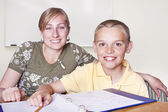 Elementary School Teacher and her student — Stock Photo