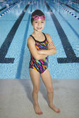 Confident Young Swimmer standing by Swimming Pool — Stock Photo