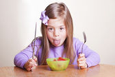 Cute little girl not wanting to eat healthy food — Stock Photo