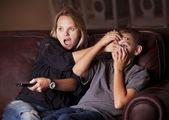 Parent Guarding Son Against Questionable TV Content — Stock Photo