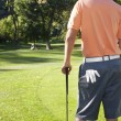 Stock Photo: Golfer standing around green of golf course