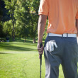 Golfer standing around green of golf course — Foto Stock #40855899