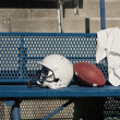 Football helmet on bench — Foto Stock #40859199